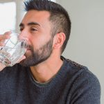 A caucasian man drinking water | Feature | 12 Interesting Reasons You Need To Drink More Water