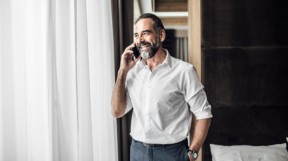 A middle age man taking on the phone | feature | Can You Slow Down Aging by Taking Human Growth Hormone?
