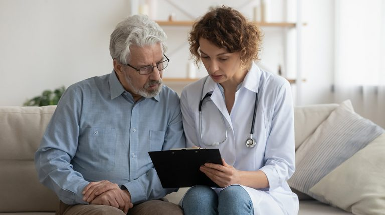 A doctor consulting health for a senior man | feature | Is Testosterone Therapy Safe?
