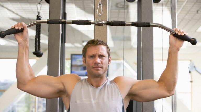 Man Weight Training At Gym | Feature | What Is a Hypertrophy Workout?