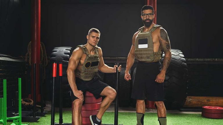 Two-men-teammates-wearing-weight-vests-during-workout | feature | How a Weighted Vest Improves Your Workout