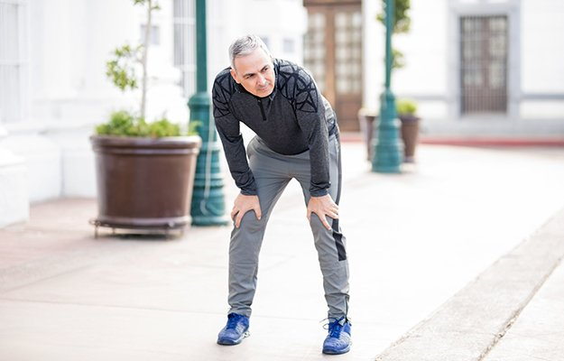 A middle aged man getting tired from walking | 6 Ways To Battle Sarcopenia (Muscle Loss) And Become Physically Fit