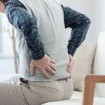 A middle aged man having backpain   feature   What Causes Osteoporosis in Men and Who Is Vulnerable to This Bone Disease?
