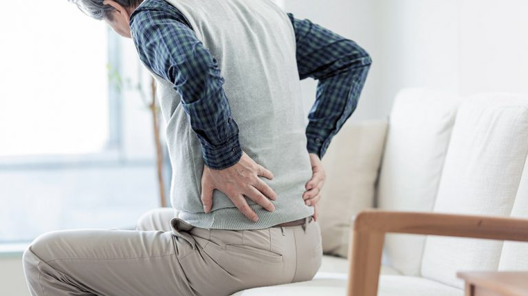 A middle aged man having backpain | feature | What Causes Osteoporosis in Men and Who Is Vulnerable to This Bone Disease?