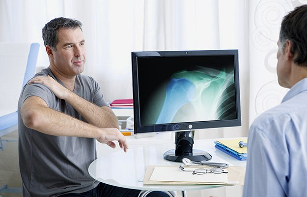A middle aged man having osteoporosis check up with doctor | What Causes Osteoporosis in Men and Who Is Vulnerable to This Bone Disease?