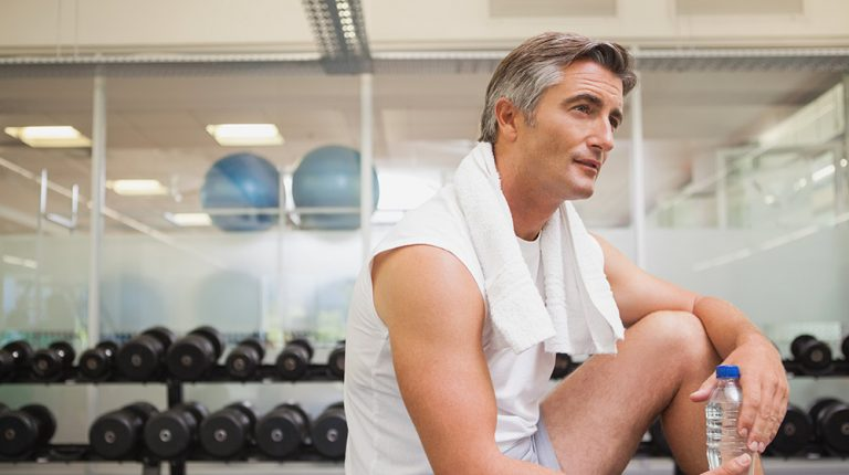 A middle aged man resting in a gym | Feature | How Does BHRT Help with Weight Loss?