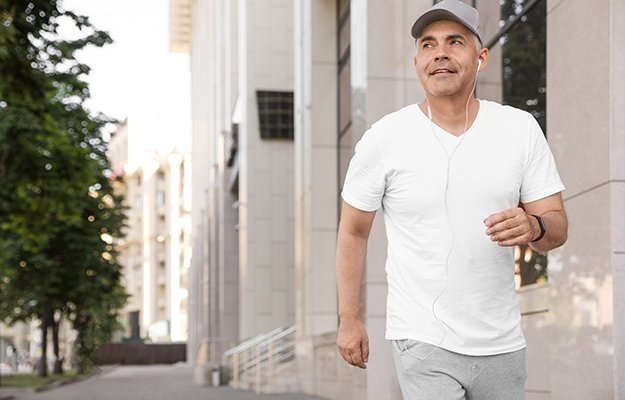 A middle aged man walking in the street | 6 Ways To Battle Sarcopenia (Muscle Loss) And Become Physically Fit