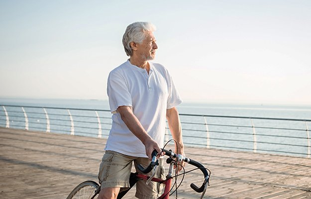 A senior man riding bicycle along the beach   9 Tell-Tale Signs of Nutrient Deficiency in Older Adults