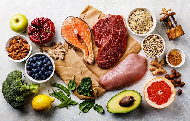 A table of healthy food, vegetable, salmon, chicken breast, fruit, bean   How A Strong Immune System Could Be The Best Response To COVID-19 & Its Variants