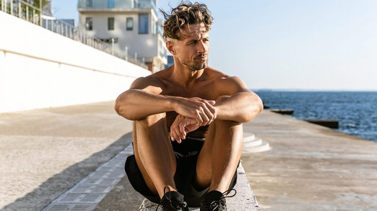 A thoughtful mature man sitting next to the sea | Feature | How A Strong Immune System Could Be The Best Response To COVID-19 & Its Variants