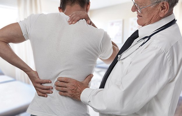 Doctor checking up a patient having back pain | What Causes Osteoporosis in Men and Who Is Vulnerable to This Bone Disease?